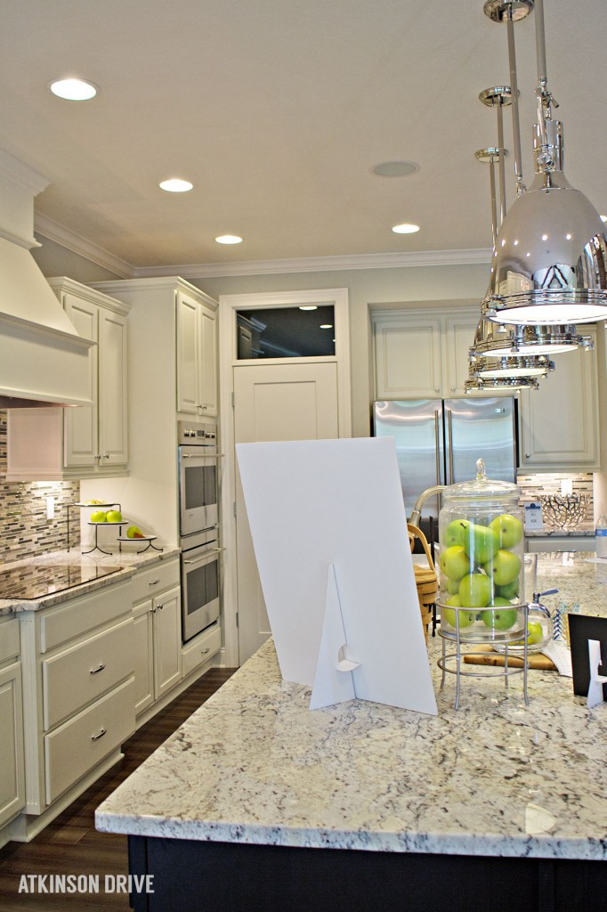 Home-a-Rama 2014: White kitchen with dark island and marble counters | Atkinson Drive