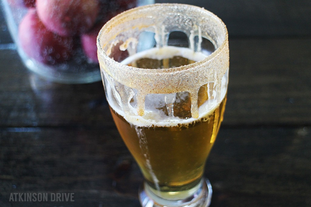 Looking for a Fall treat to beat the heat? This chilled caramel apple cider (just for grown-ups) is the perfect early Fall cocktail!